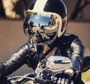 Dennily Lerner on a motorcycle